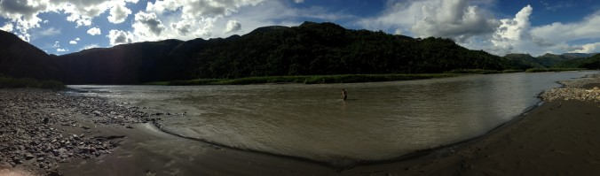 The gaucho swims in the river.